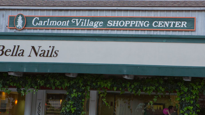 a carlmont village shopping center sign
